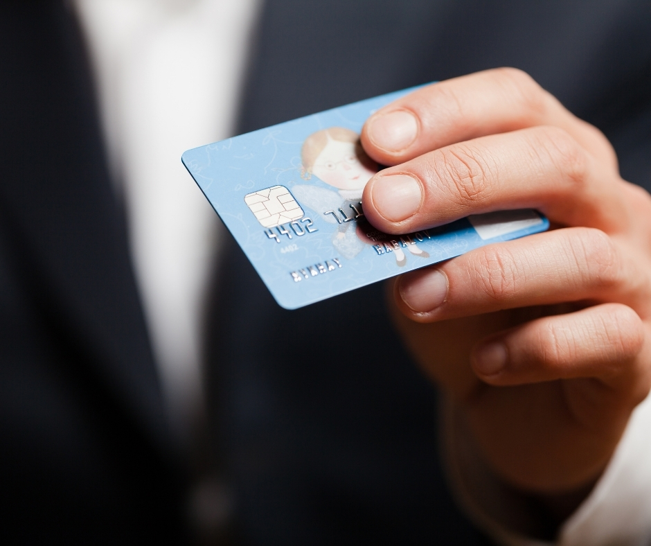 Man holding debit card